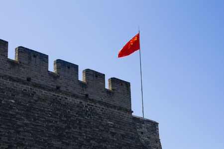 ancient city walls and national flag in Beijing China photo