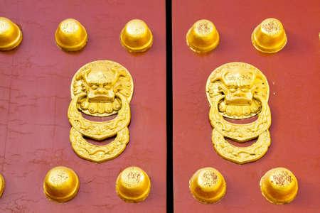 Ancient red Temple door in beijing china photo