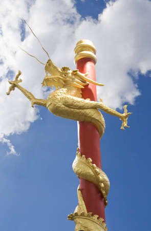 a chinese dragon with blue sky and white cloud background Stock Photo - 5786176