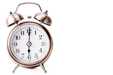 Copper alarm clock showing 6 oclock side leaving a blank