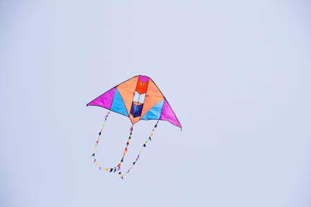 colorful kite flying in the blue sky photo