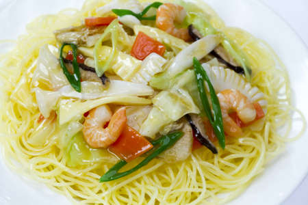 Pasta with shrimps and healthy vegetables photo