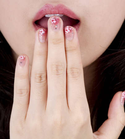 beautiful young woman with red lips and nail art photo