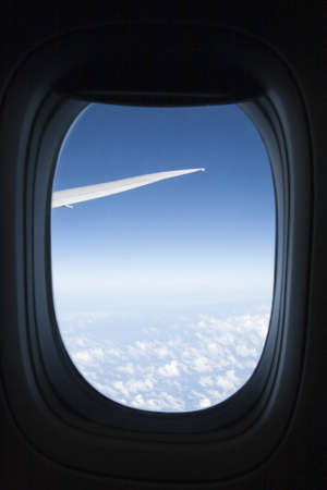 aeronautical: A view of clouds from an airplane window.
