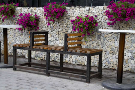 beautiful fence of a outdoor dining room with flowers photo