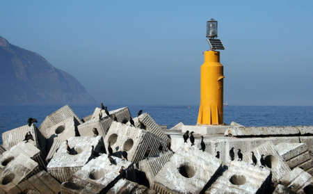power operated: lighthouse operated by solar power at sea coast  Stock Photo