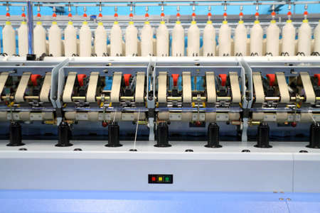 Cotton yarn production in a textile factory  photo