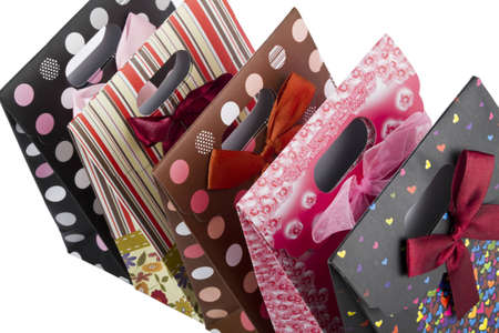 Bunch colorful paper bags for gifts isolated on white Stock Photo - 9706946