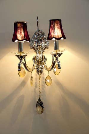 wall lamp on a wall at night photo
