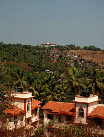 national plant: Mapusa, India, GOA, coconut palm architecture house home estate city residential facade perspective rural travel tourist non-urban national idyllic real old-fashioned park street garden terraced village comfortable cottage places panoramic balcony plant n Stock Photo