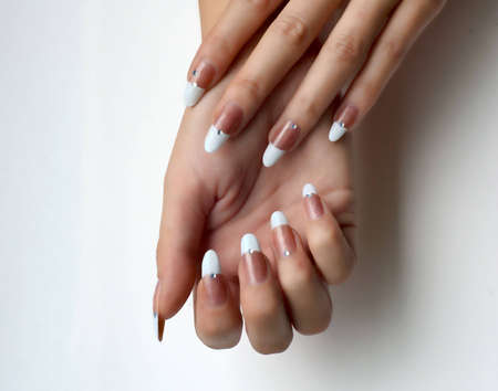 finger tip: French manicure Stock Photo