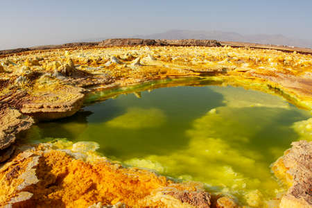 Acid yellow-green pool, and eggshell-like ground that ejects poisonous gas. In Dallol, the Danakil Depression, Ethiopia