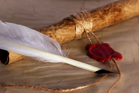 seal wax: old paper, ancient parchment  scroll with wax seal and quill pen Stock Photo