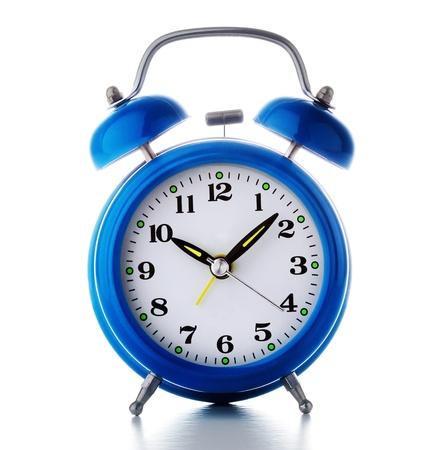 Old blue alarm clock on a white бацкгроунд. Старый синий будильник на белом фоне photo
