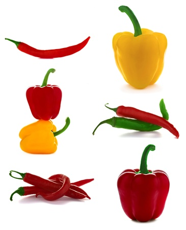 Set of different sweet and chili peppers isolated on the white photo