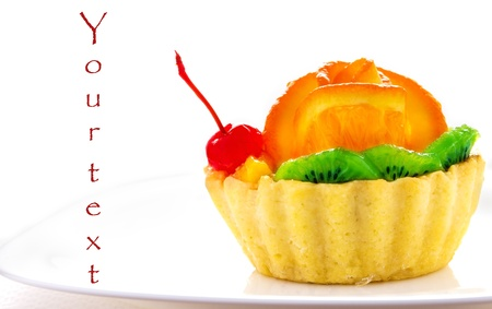 Cupcake decorated with fruit  on a white background for your text Stock Photo - 21970425