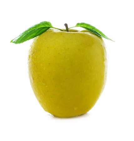 fresh and wet yellow apple with green leaf with water and with drops isolated on a white background photo