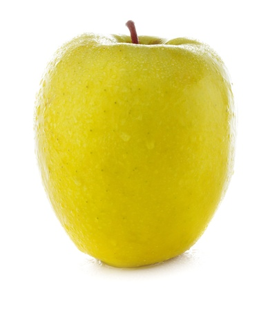 fresh and wet yellow apple  with water isolated on a white background photo