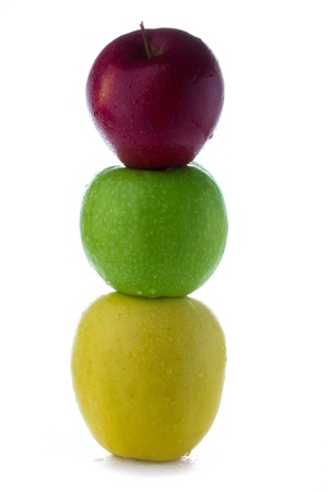 fresh green yellow red apples in the form of a traffic light isolated on a white background photo