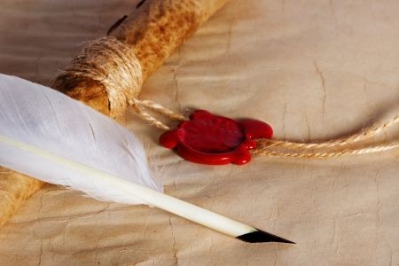 old paper, ancient parchment  scroll with wax seal and quill pen photo