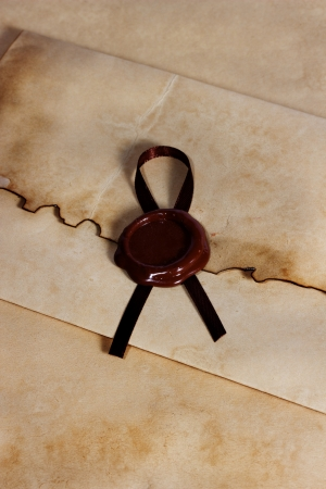 old envelope of ancient parchment paper with a wax seal photo