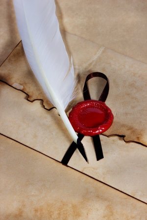 old paper, envelope of ancient parchment with wax seal and quill pen photo