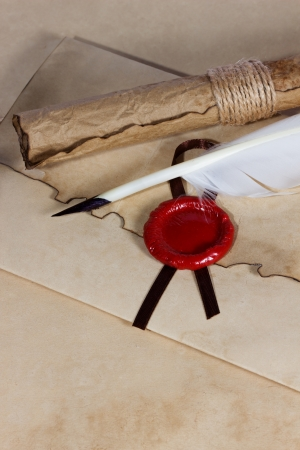 old paper, ancient parchment  scroll, envelope with wax seal and quill pen photo