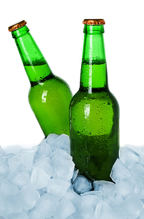 Two bottles of beer on ice isolated photo