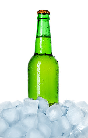 bottle of beer on ice isolated photo