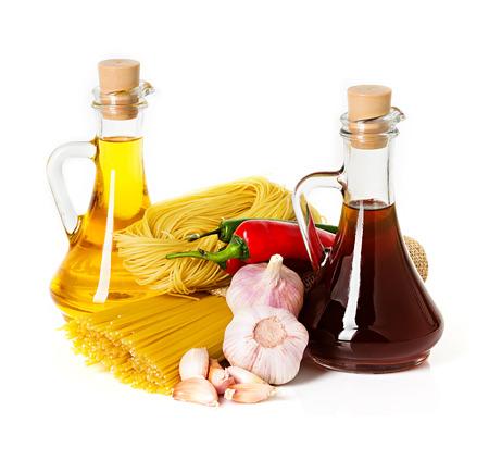 Ingredients for pasta  Spaghetti, chili, oil, garlic isolated on white photo