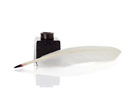 inkwell with quill pen photo
