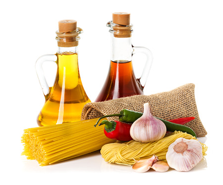 italy culture: Ingredients for pasta  Spaghetti, chili, oil, garlic isolated on white