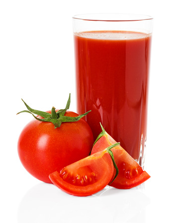 Drinking glass with tomato juice and ripe fresh tomato near isolated on the white background photo