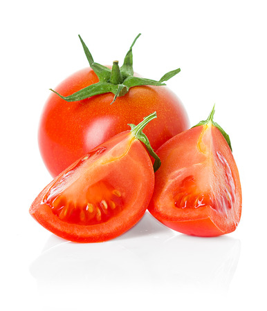 Tomatoes  Whole and a half isolated on white photo