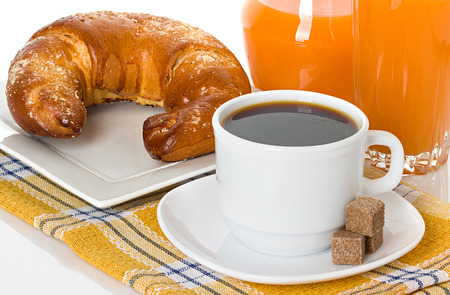 cup of coffee, fresh croissant and juice orange photo