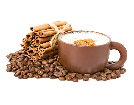 cappuccino in a cup on a background coffee grains with cinnamon sticks Banque d'images