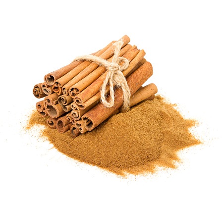 Cinnamon sticks and powdered cinnamon isolated photo