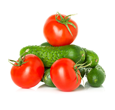 Red tomatoes and green cucumbers Imagens