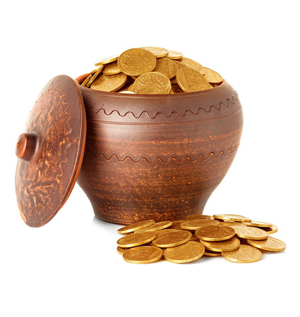 Golden coins in ceramic pot, isolated photo