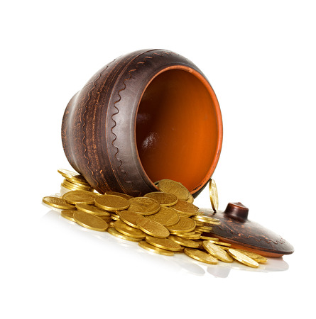 Golden coins in ceramic pot, isolated