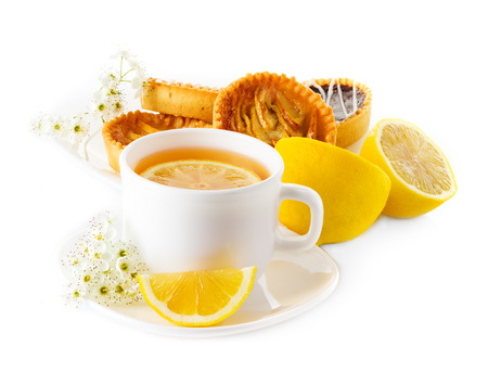 cup of tea with lemon and pastries photo