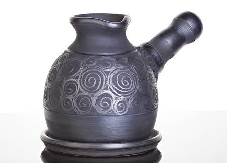 cezve: Ceramic, clay cezve on black background Stock Photo