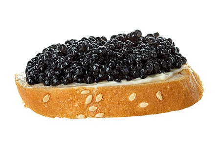Black caviar served on bread isolated photo