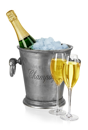 stemware: Bottle of champagne  in ice bucket with stemware isolated on white background