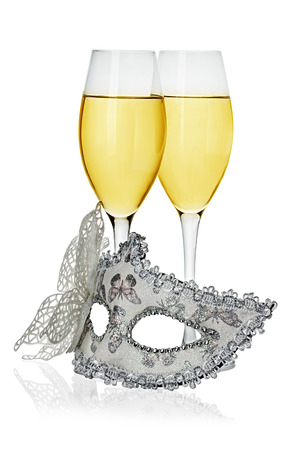 Carnival mask and glasses with champagne isolated on white background photo