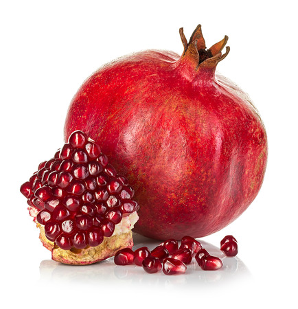 Ripe pomegranates isolated on a white background.