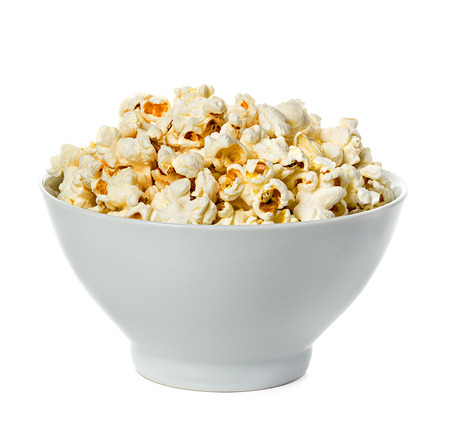 glass bowl: Popcorn isolated on a bowl