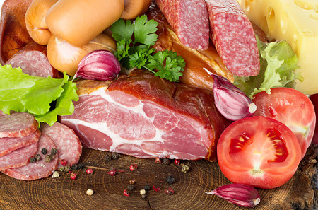cold background: Variety of sausage products. Background. Stock Photo