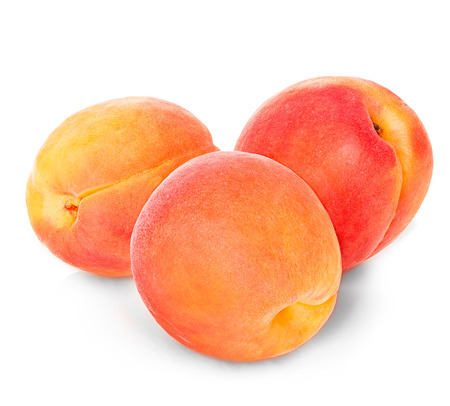 apricot kernels: Apricots isolated on a white background.