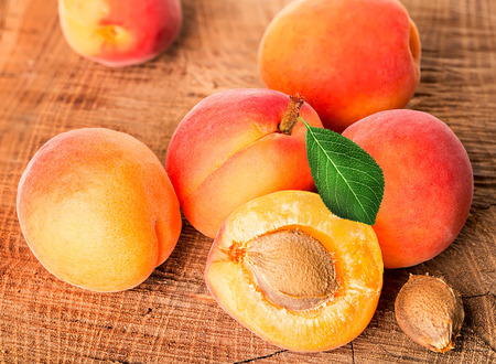 apricot kernels: Apricots on the wooden background